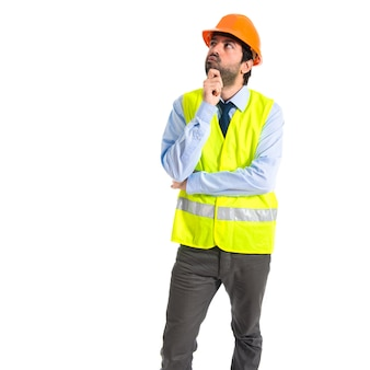 Worker thinking over white background