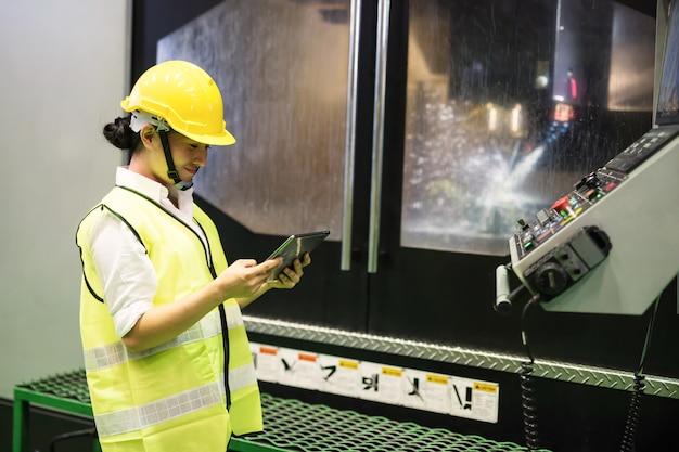Worker in uniform check robot machine