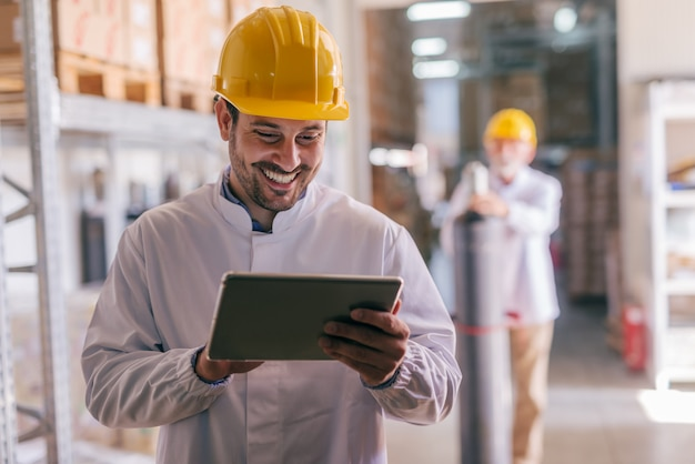 Worker using tablet in warehouse.