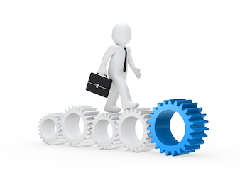 Worker walking along gears of different sizes