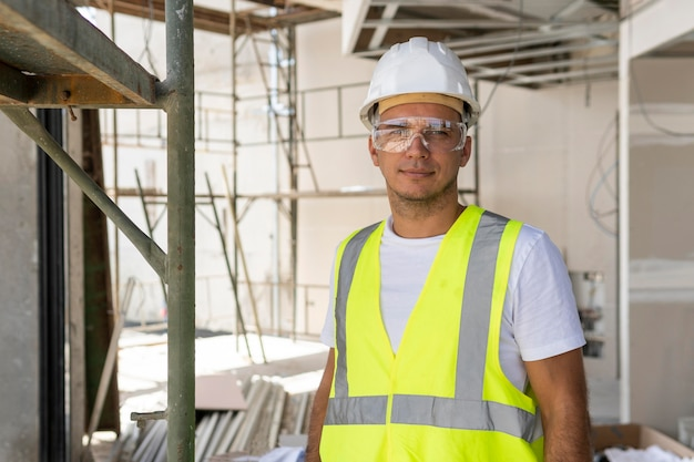 Worker wearing safety glasses on a construction site