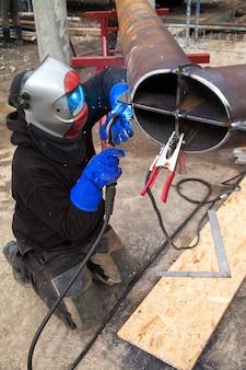 Worker welding in a factory. welding on an industrial plant.