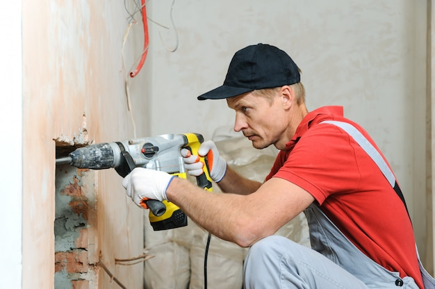 Worker with an electric hammer.
