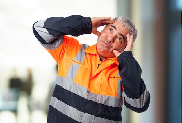 Worker with hands on head