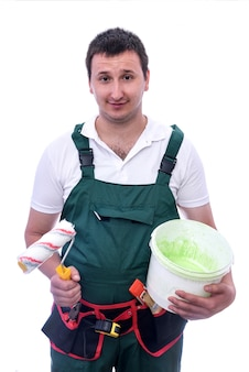 Worker with painting tools on white