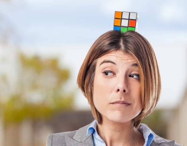 Worker with the rubik's cube on the head