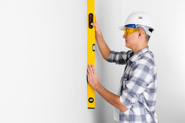 Worker with spirit level with copy space