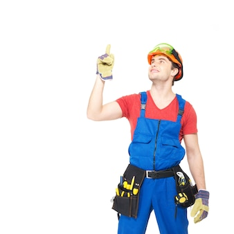Worker with tools  points up with finher isolated on white