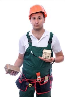 Worker with wooden toy house and samplers