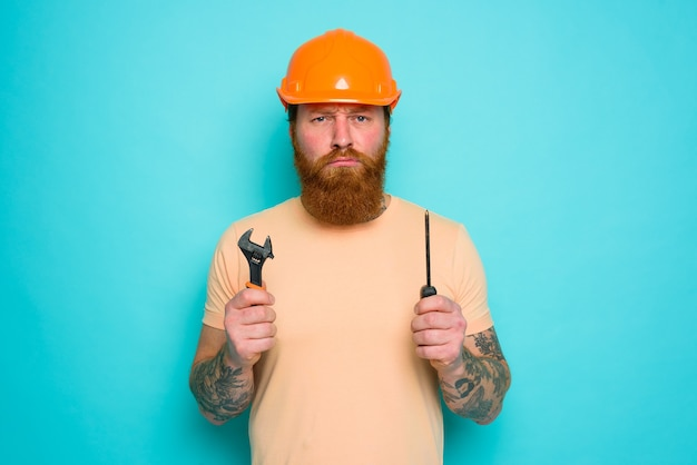 Worker with yellow hat is confused about his work