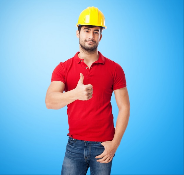 Worker with yellow helmet on blue background