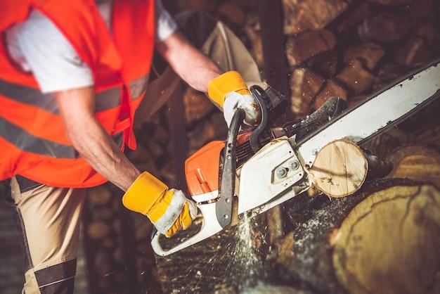 Worker wood cutting