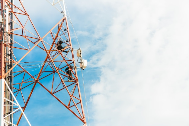 Worker work on mobile tower