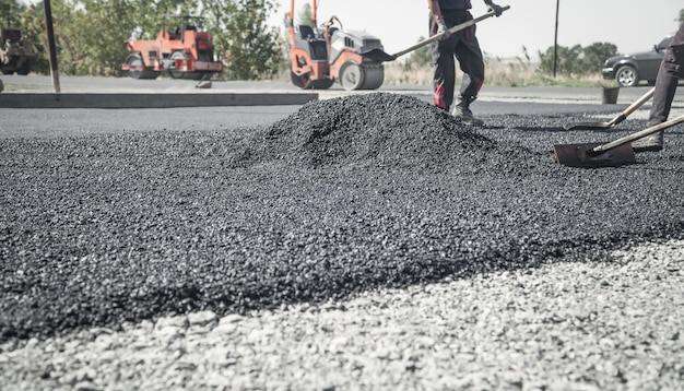 Workers arranging asphalt