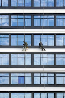 Workers clean the windows on the skyscrapers.