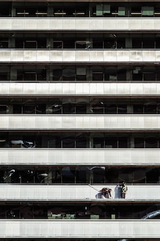 Workers cleaning and repairing the exterior of a building