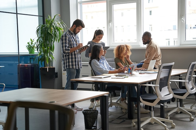 Workers doing brainstorm together in conference room