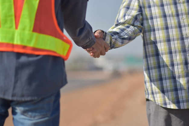 Workers doing handshake