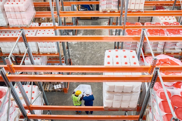 Workers doing inventory in warehouse