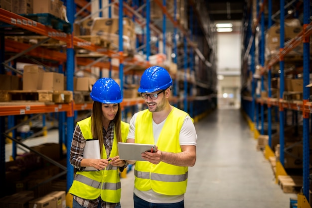 Workers in large distribution warehouse