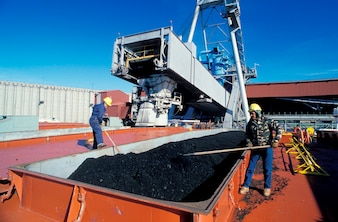 Workers loading coal