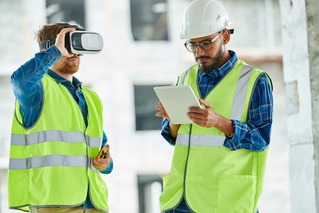Workers using visual simulation on site