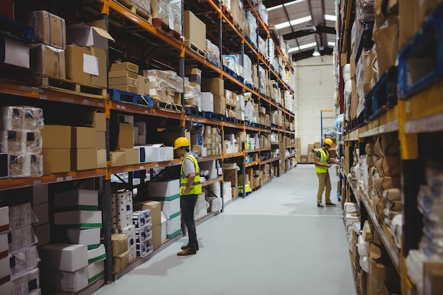 Workers in warehouse wearing helmets