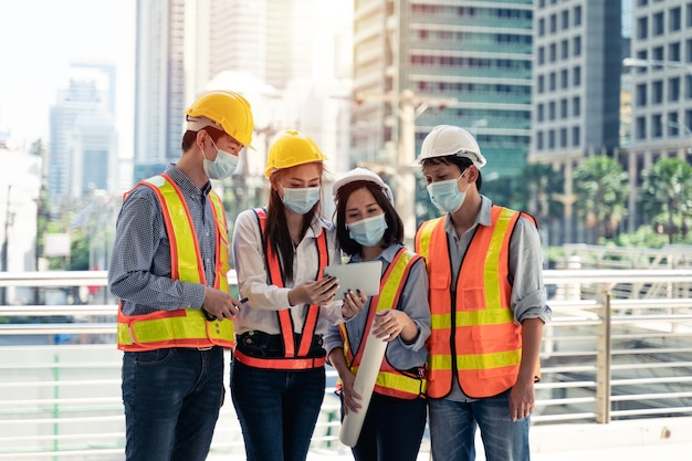 Workers waring surgical mask and safety white head to protect for pollution and virus