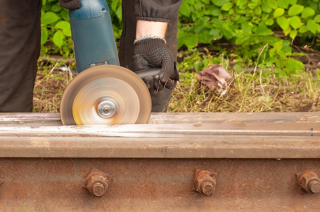 Workers were cutting tracks for maintenance, sparks fly