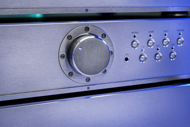 Working audio amplifier with lighting, close-up.
