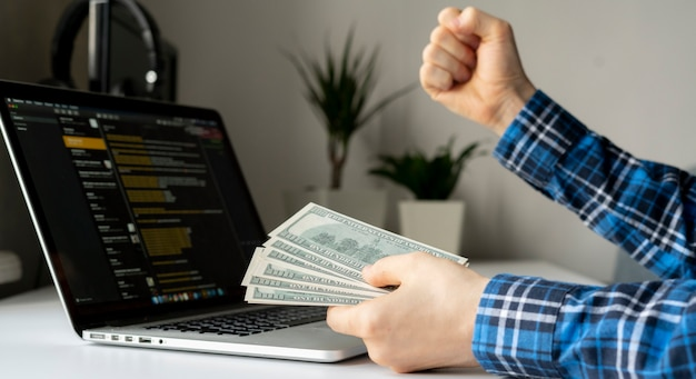 Working at home. side hustle, person earned money via computer using the internet