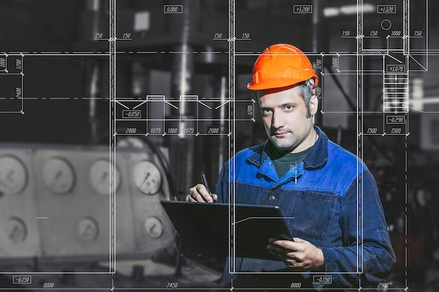 設計図からの機械の背景に対して生産で働く