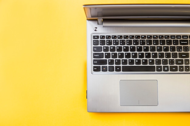 Working laptop on a yellow background