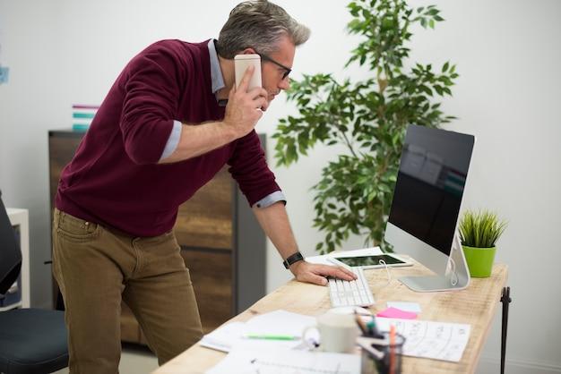 Working man bending over the desk