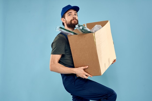 Working man boxes in hands delivery service packaging lifestyle blue space.