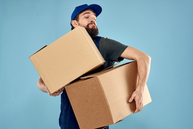 Working man boxes in hands delivery service packaging