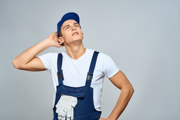 Working man in uniform service lifestyle delivery service light wall.