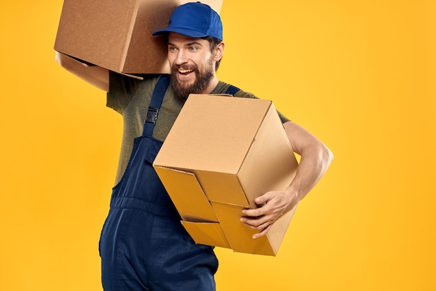 Working man with box in hands delivery loading transportation service