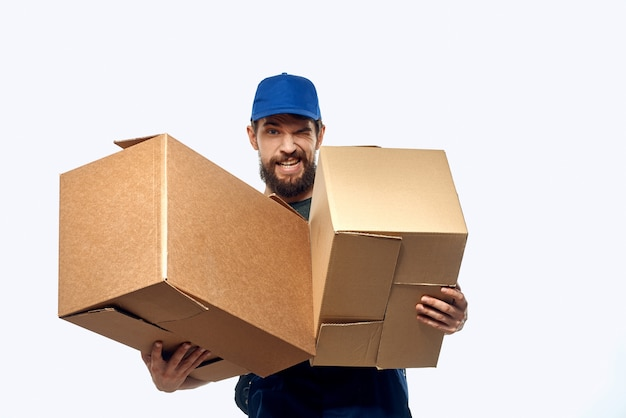 Working man with boxes in hands delivery service work lifestyle