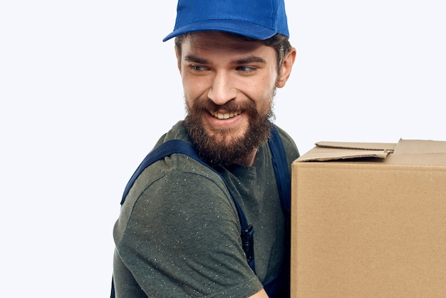 Working man with boxes in hands delivery service work lifestyle.