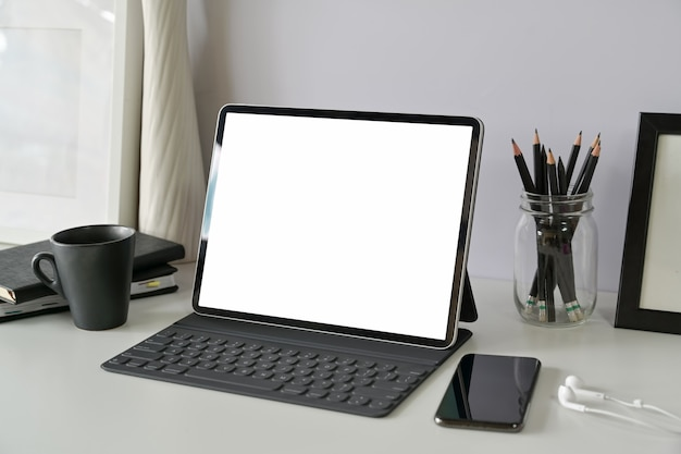 Working place with blank screen mockup tablet