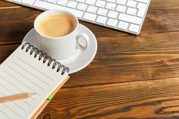 Working place at wooden desktop with coffee