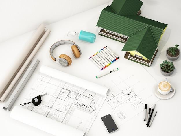 白いテーブルに構造画用紙と家モデルの作業スペース