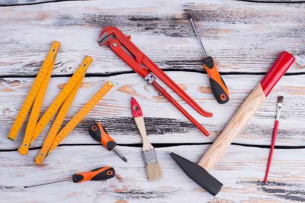 Working tools and instruments on wooden background