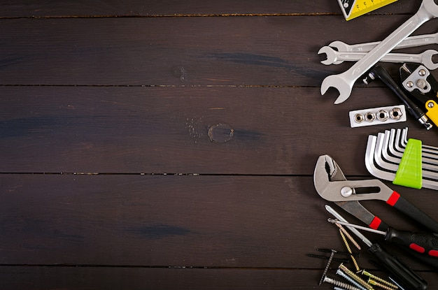 Working tools on wooden rustic background. top view. copy space