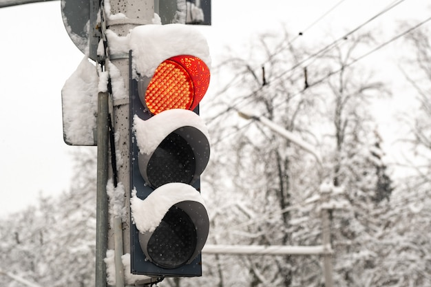 Working traffic light on a city street in winterthe red light of the traffic light is on