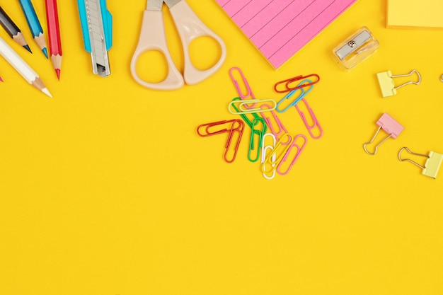 Working with equipment such as paint and paper on a yellow background