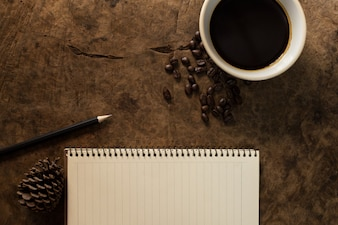 Working with notebooks and coffee mugs on wooden floors.
