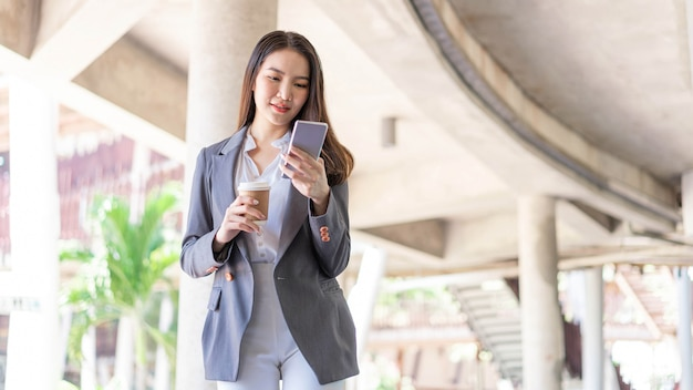Working woman concept a young female manager attending video conference and holding a cup of coffee.