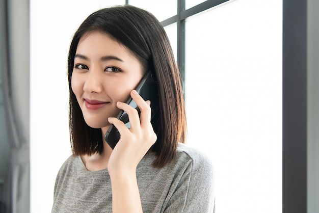 Working woman talking on the mobile phone